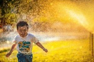 child-running-water